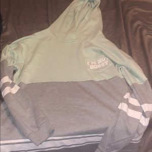 A mint and grey colored sweatshirt